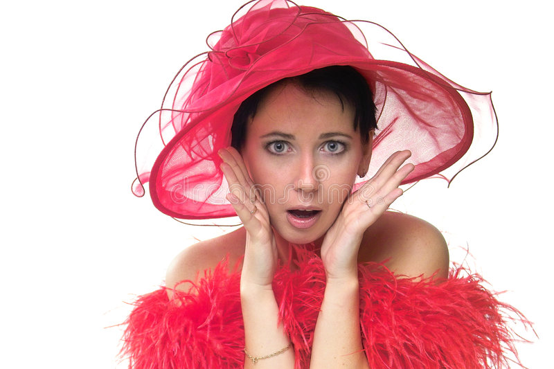 Oh my God!. Portrait of a beautiful surprised young woman wearing a red hat and feathered red boa over naked shoulders stock image