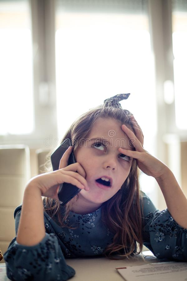 Oh, my God, mom, sometimes you`re really boring. Little school girl taking on phone. Copy space stock images