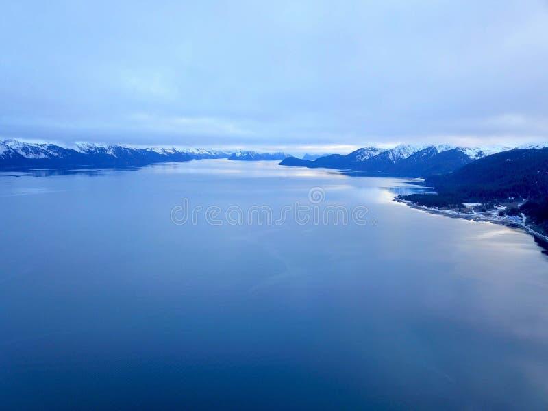 Oh my God Resurrection nay Alaska. Flying over Resurrection bay Alaska during the winter in all her glory stock photos