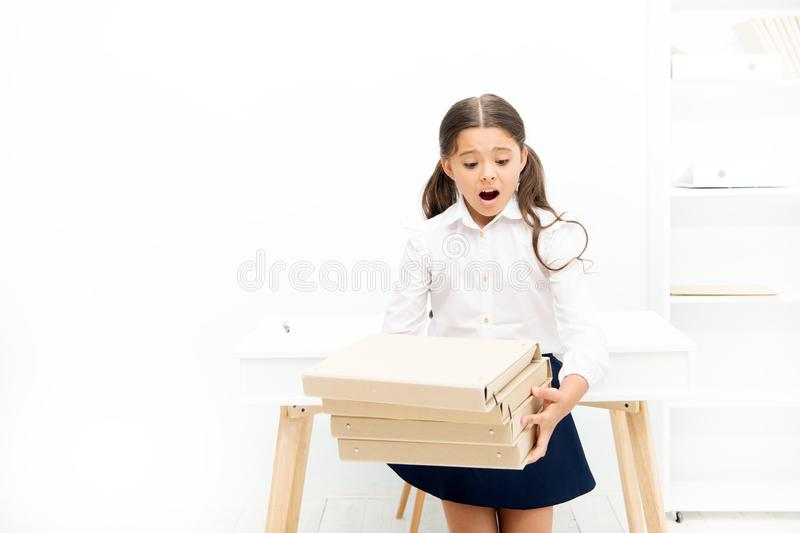 Oh no. kid learn and study hard. back to school. shocked girl with workbook folders. Education. heavy documents. Towards. Knowledge. small girl in school stock photo