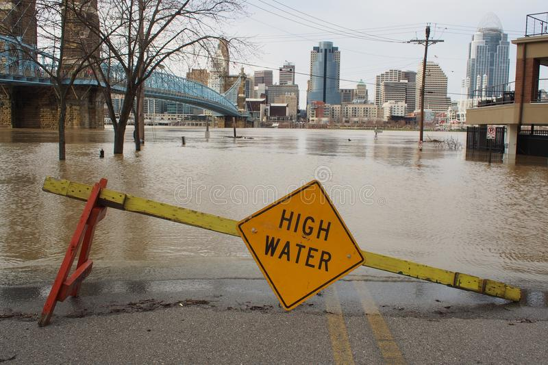 Ohio River flood 2018 with Cincinnati skyline. A high water sign on closed road in Covington, Kentucky, across river from Cincinnati on Feb. 25, 2018, when the stock image