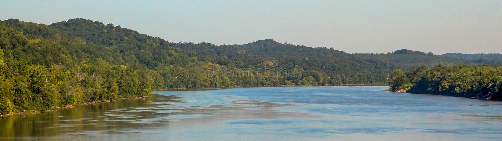 Ohio River Panoramic. The Ohio River in the summer with trees banking the sides and the water smooth royalty free stock photos
