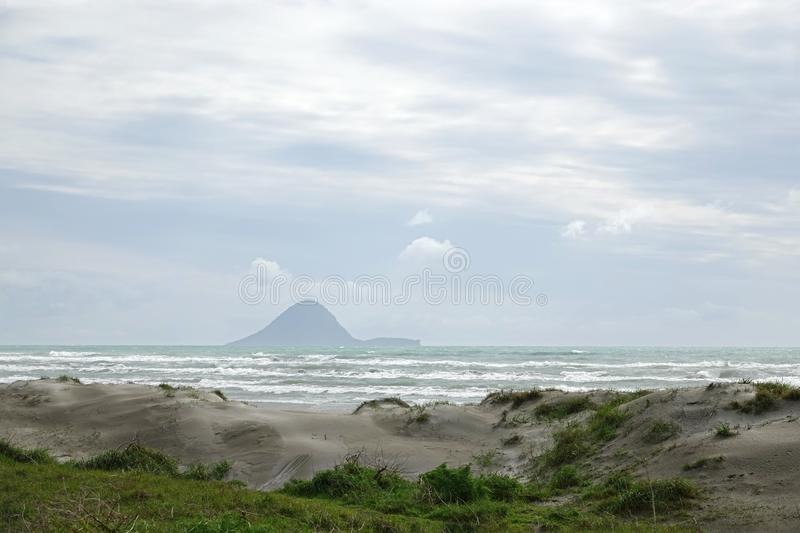 Moutohora or Whale Island from Ohope beach in Whakatane, New Zealand. Ohope beach in the Bay of Plenty on the North Island of New Zealand is voted as New Zealand stock image
