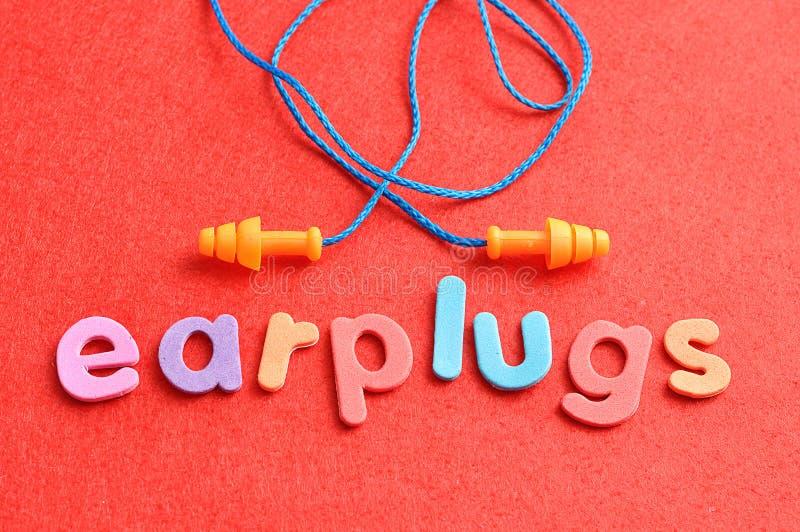 Ohrenpfropfen mit den Wortohrenpfropfen lizenzfreies stockfoto