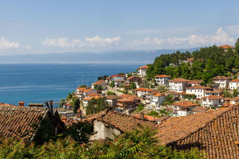 Ohrid city and Lake Ohrid. Nice houses on a hill at Ohrid City with Lake Ohrid in the background stock photography