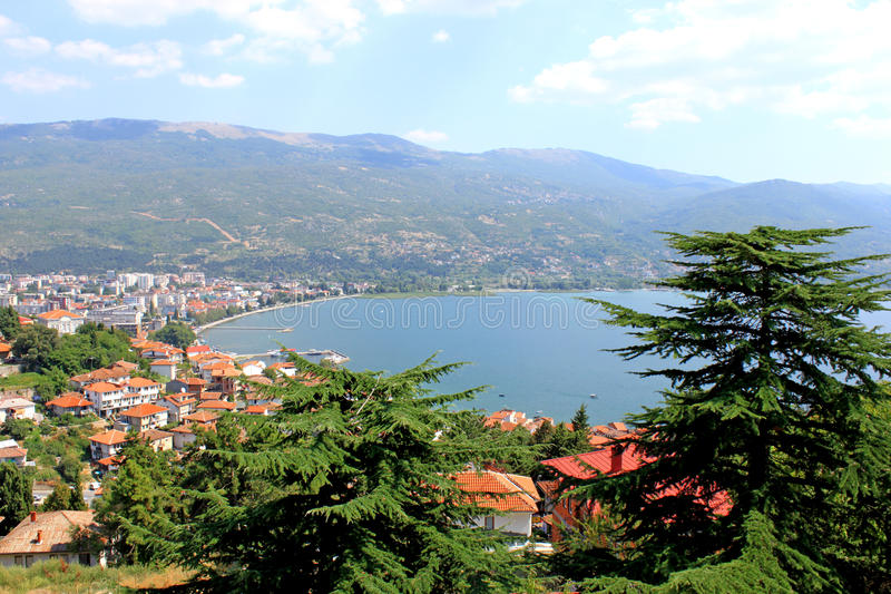 Ohrid Lake. Aerial view of Ohrid Lake, city of Ohrid and mountains in the background. Pine-trees in the foreground. Ohrid is a Macedonian resort and famous stock image