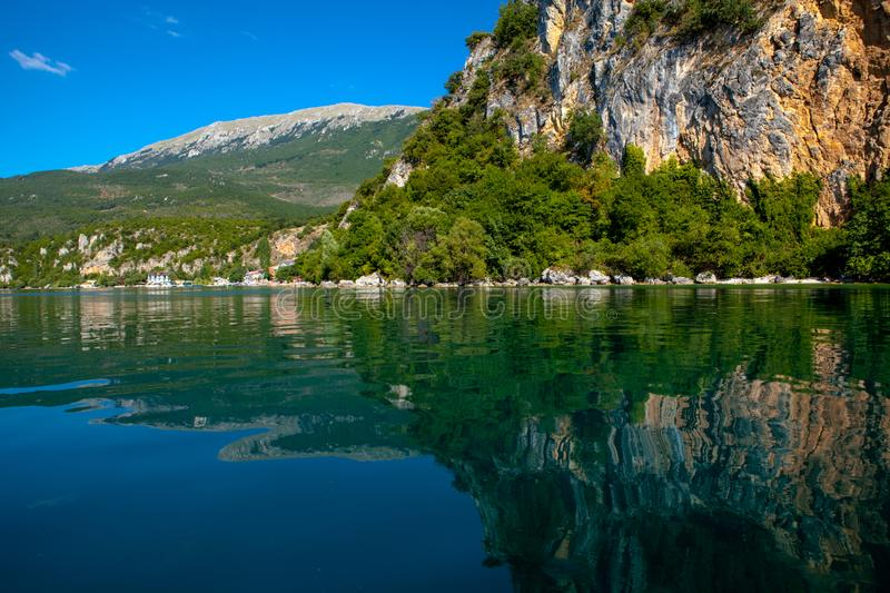 Ohrid Lake coastline with clear reflections. This is a picture of Ohrid Lake coastline with clear reflections in the water. The waters in Ohrid lakes are stock photography