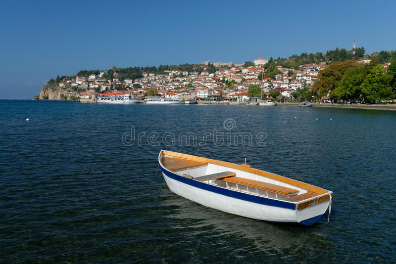 Ohrid lake. Fishing boat with the view of an old town of Ohrid. In the background royalty free stock photography