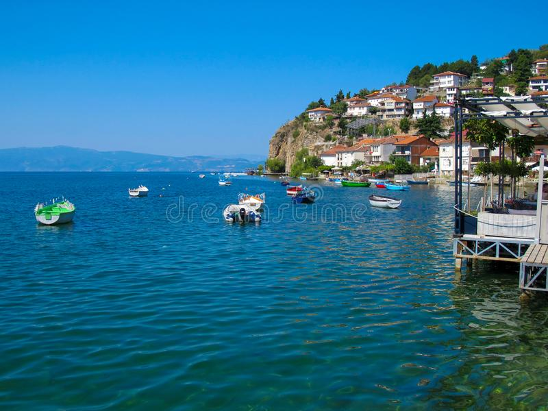 Ohrid lake, Macedonia on lovely summers day. This is a picture of Photo of Ohrid city and lake, Macedonia on a lovely summers day with boats and houses stock images