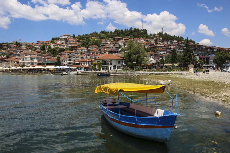 OHRID, MACEDONIA - JUNE 10, 2019: Fishing boat in the background historical part town Ohrid, UNESCO heritage listed, Republic of. OHRID, MACEDONIA - JUNE 10 stock image