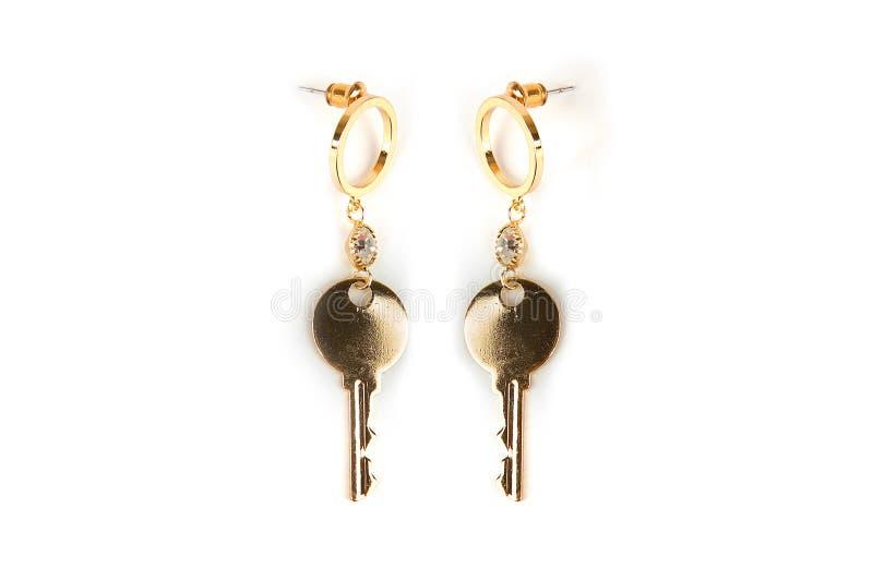 Ohrringe in Form von Schlüsseln 2 Schlüssel vom Verschluss lizenzfreie stockbilder