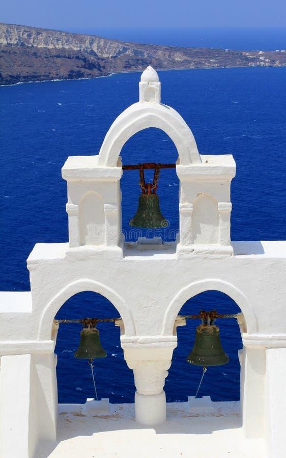 Oia Church Bells Against Blue Aegean Sea stock photos