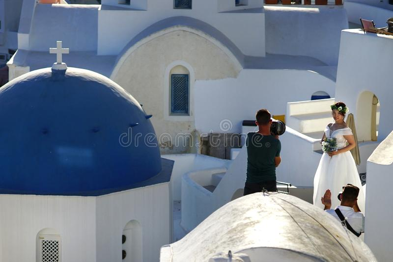 OIA, GRECIA, casandose el 19 de septiembre de 2018 las fotografías en ubicaciones hermosas fotografía de archivo