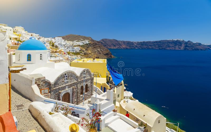 Oia, Santorini - Greece. Famous attraction of white village with cobbled streets, Greek Cyclades Islands, Aegean Sea. royalty free stock photos