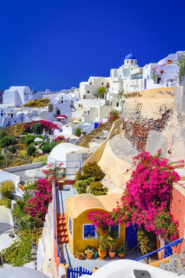 Oia, Santorini island, Greece. Traditional and famous white houses and churches with blue domes over the Caldera, Aegean sea. royalty free stock photos