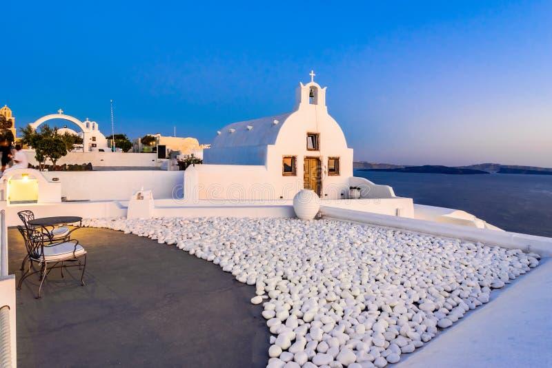 Oia stad, Santorini-eiland, Griekenland bij zonsondergang Traditioneel en FA stock foto