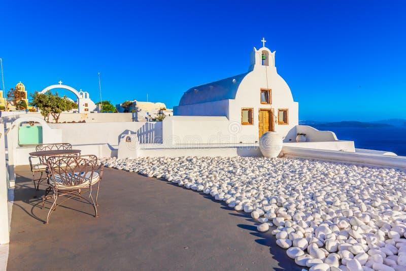 Oia stad, Santorini-eiland, Griekenland bij zonsondergang Traditioneel en FA stock afbeelding