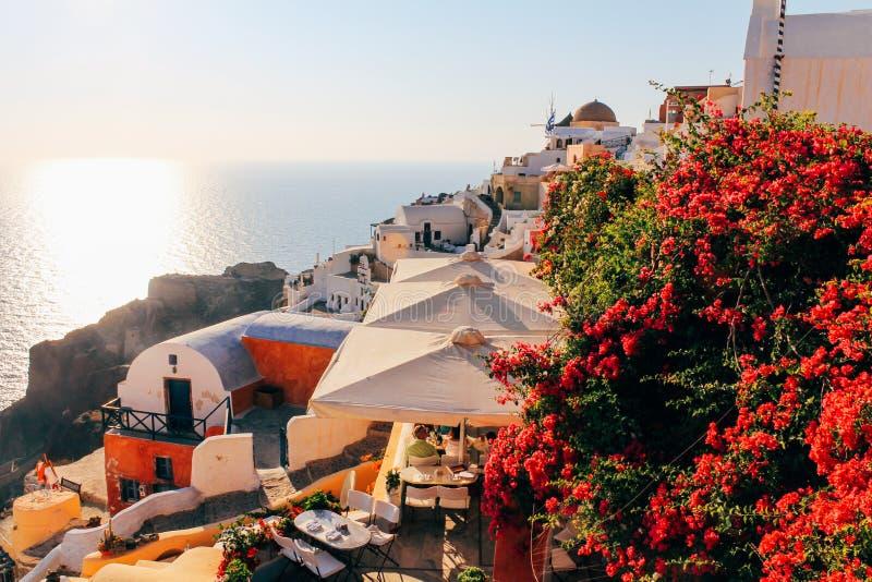 Oia stadszonsondergang in Santorini-eiland, Griekenland stock afbeelding