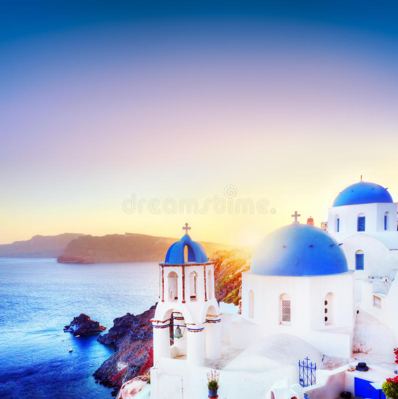 Oia town on Santorini Greece at sunset. Aegean sea. Oia town on Santorini Greece at sunset. Traditional and famous white houses and churches with blue domes over stock image