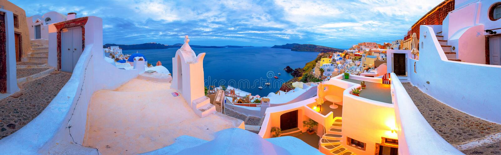 Oia town on Santorini island, Greece. Traditional and famous houses and churches with blue domes over the Caldera. stock image