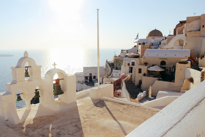 Oia town and sea at sunset in Santorini island stock images