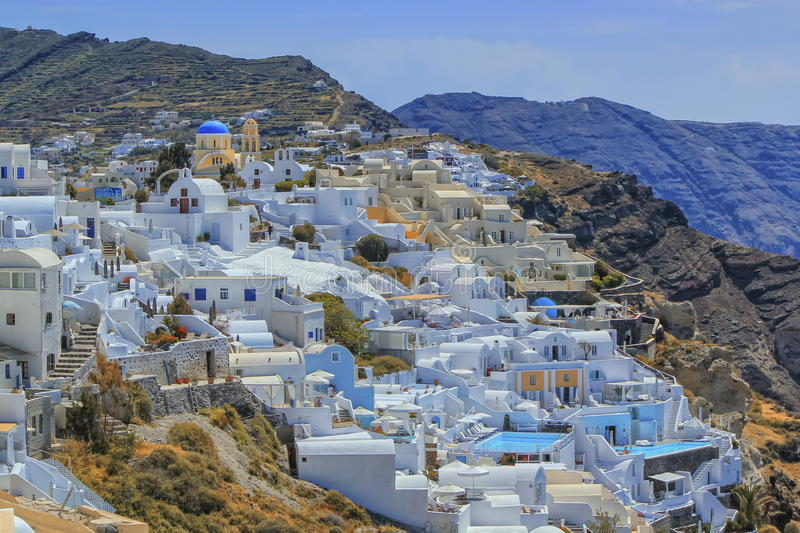Oia village on Santorini island, north, Greece. View of colorful Oia village on Santorini island by beautiful day, Greece stock images
