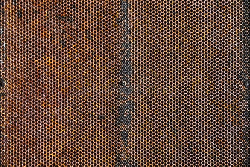 Oid and Grunge Weathered Rusty Metal Plate with Pattern Holes Te royalty free stock photo