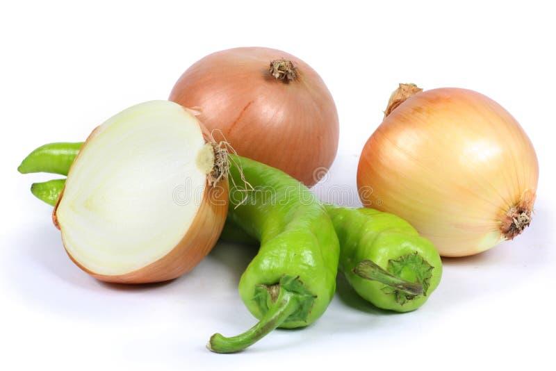 Oignon, poivre vert photographie stock libre de droits