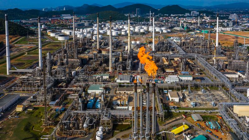 Oil refinery and petrochemical plant industrial working with fire and blue sky background, Aerial view oil and gas stock images