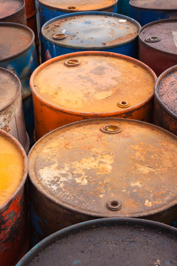 Oil barrels. Rows of rusty oil barrels stock photo