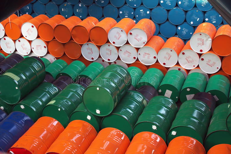 Oil barrels. Colored oil barrels stored at warehouse on a cargo ship stock image