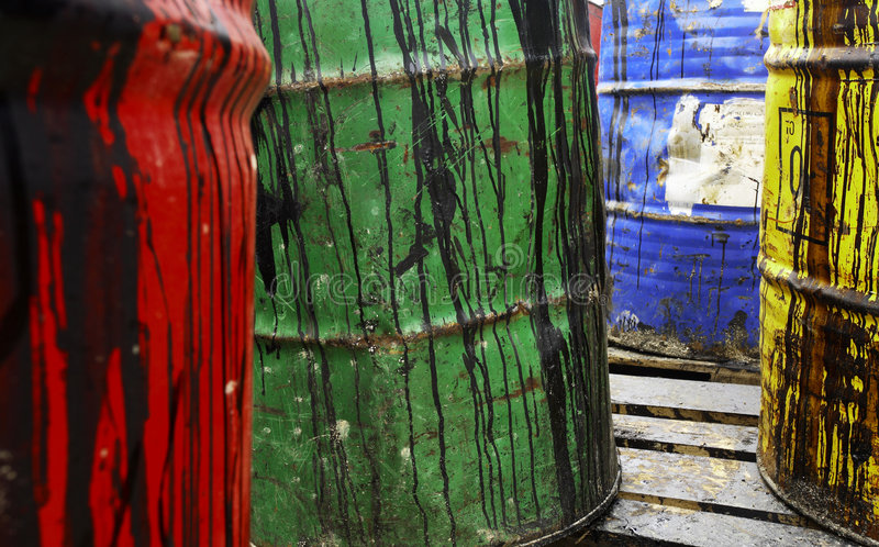 Oil barrels. Grungy and colorful used oil barrels stock photography