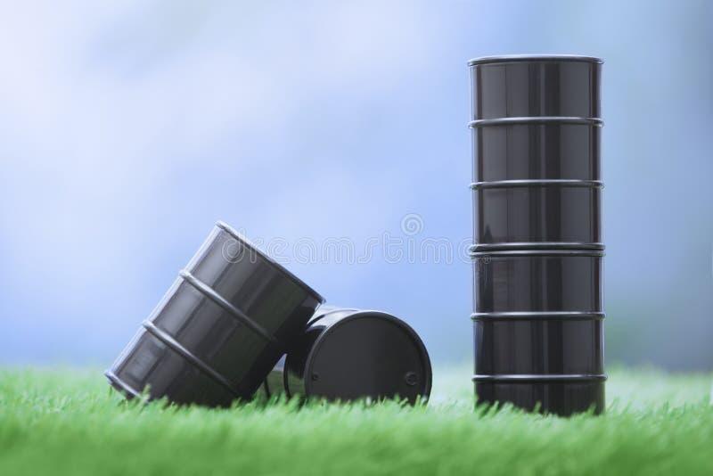 Oil barrels in the grassland stock image