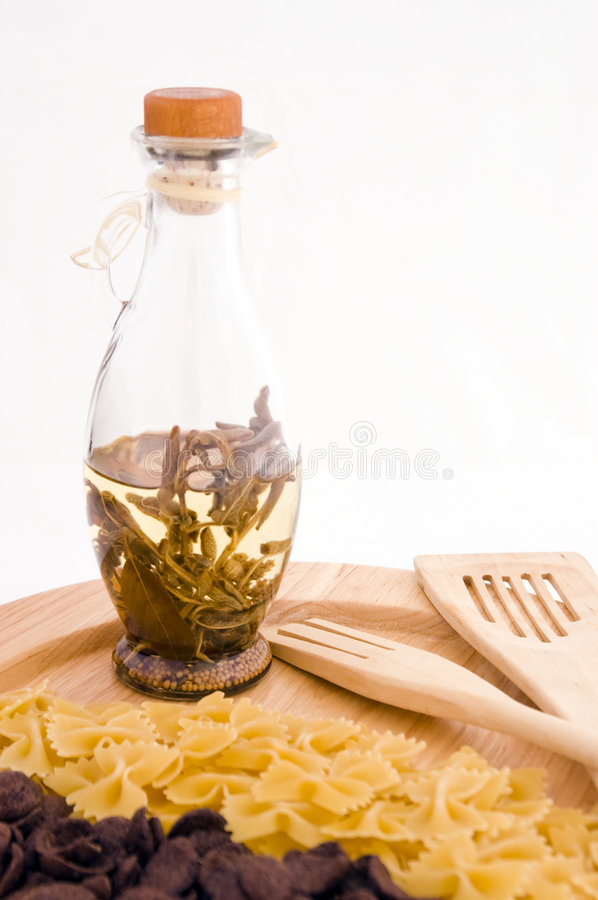 Oil bottle. With pasta and chocolate cereal stock photography
