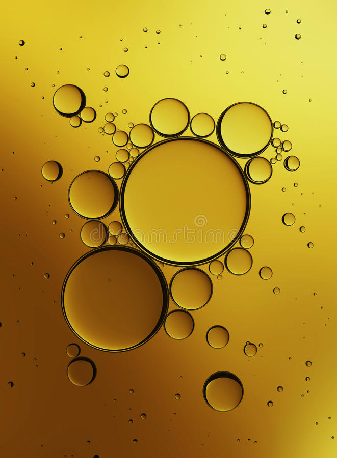 Oil Bubbles Isolated on White Background, Closeup Collagen Emulsion in Water. Illustration. Gold Serum Droplets. stock images