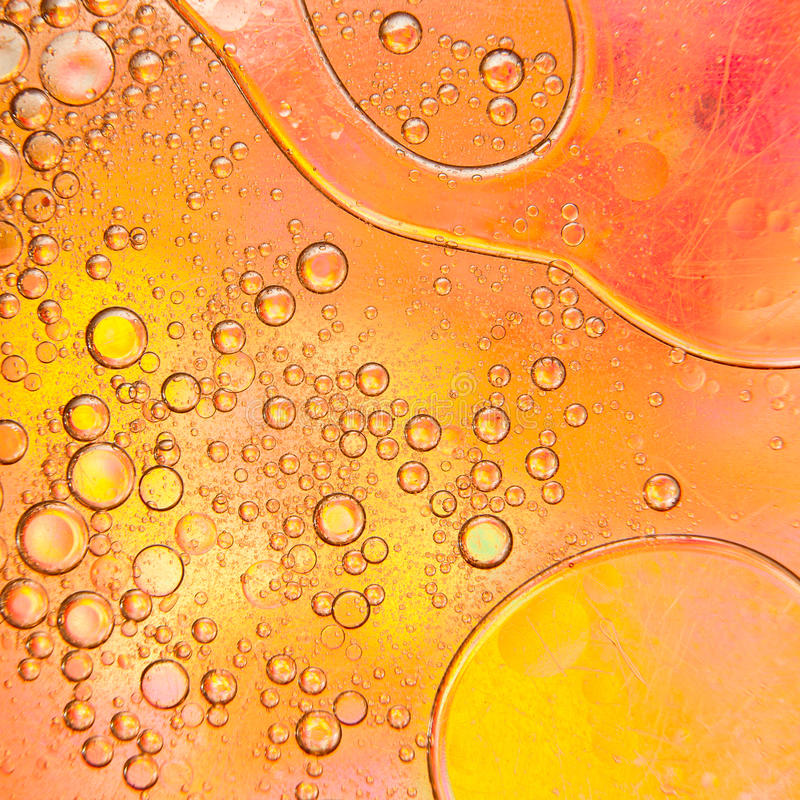 Oil bubbles on a water surface royalty free stock images