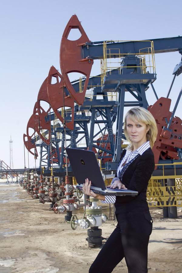Oil business. Work of young business women in oil industry stock photography