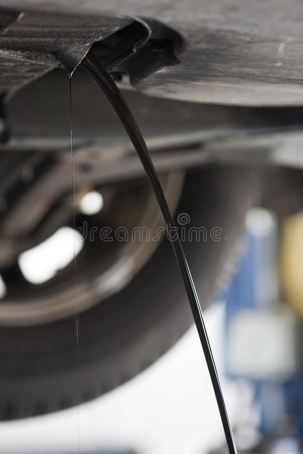 Oil Change. A car gets its oil changed at an auto shop stock image