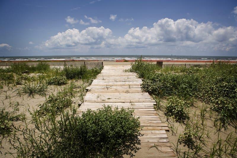 Oil Closed Beach & Boardwalk, Gulf Coast. A small wooden boardwalk leads to a closed beach on Louisiana's Gulf Coast stock images