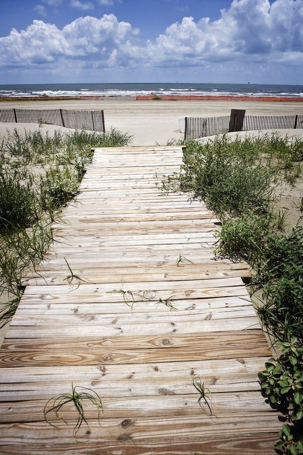 Oil Closed Beach & Boardwalk, Gulf Coast. A small wooden boardwalk leads to a closed beach on Louisiana's Gulf Coast royalty free stock photography