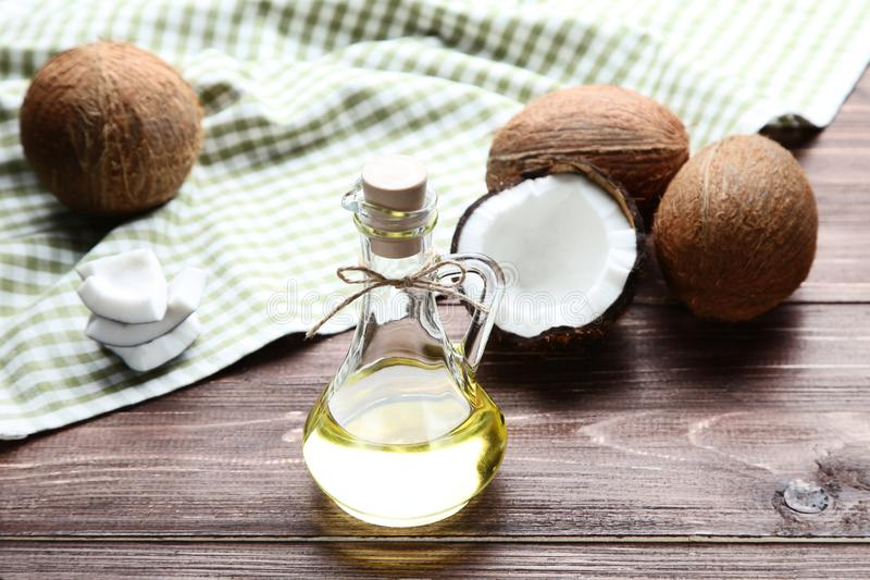 Oil with coconuts and napkin royalty free stock images