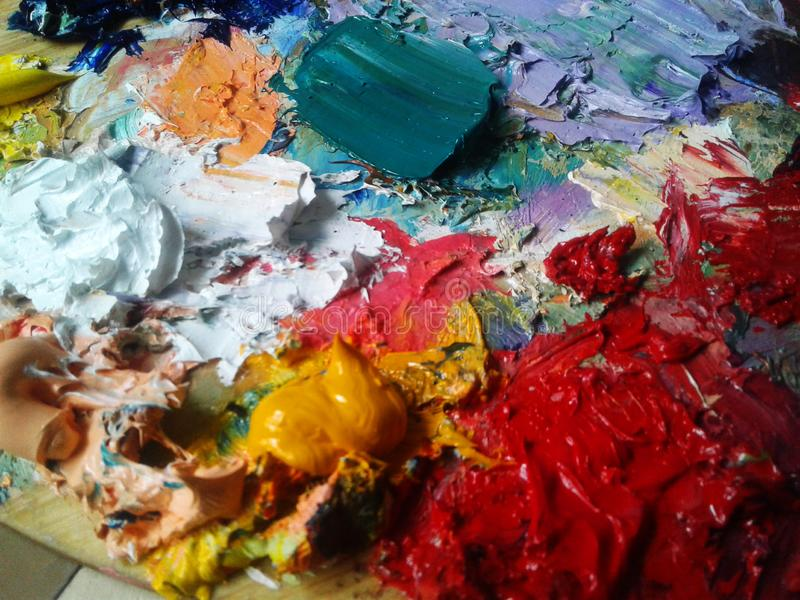 Oil color palette with rich colors and drawing inspiration. Oil color palette with rich colors arts inspiration, painting, artist, workshop, holidays stock image