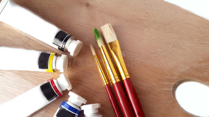 Oil colors tubes and brushes stock images
