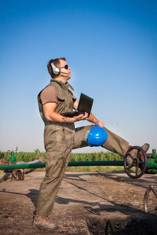 Download Oil Company Worker On The Well Stock Image - Image: 25549573