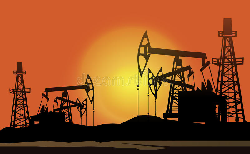 Oil Derrick In The Sunset Background Royalty Free Stock Images