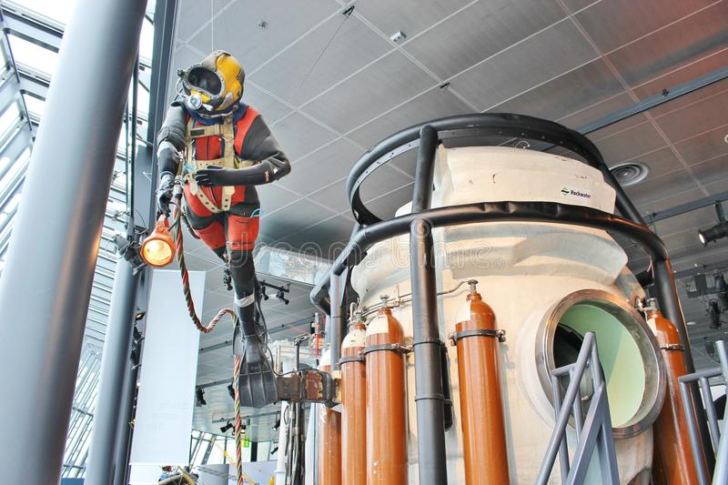Oil diver in the Stavanger Petroleum Museum, Norway, Europe. STAVANGER, NORWAY - AUGUST 5, 2015: A diver and a historic diving capsule in the Norwegian Petroleum stock images