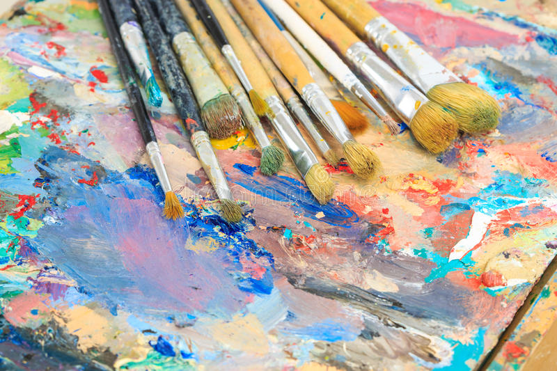 Oil drawing board with pen. Brush palette royalty free stock photos