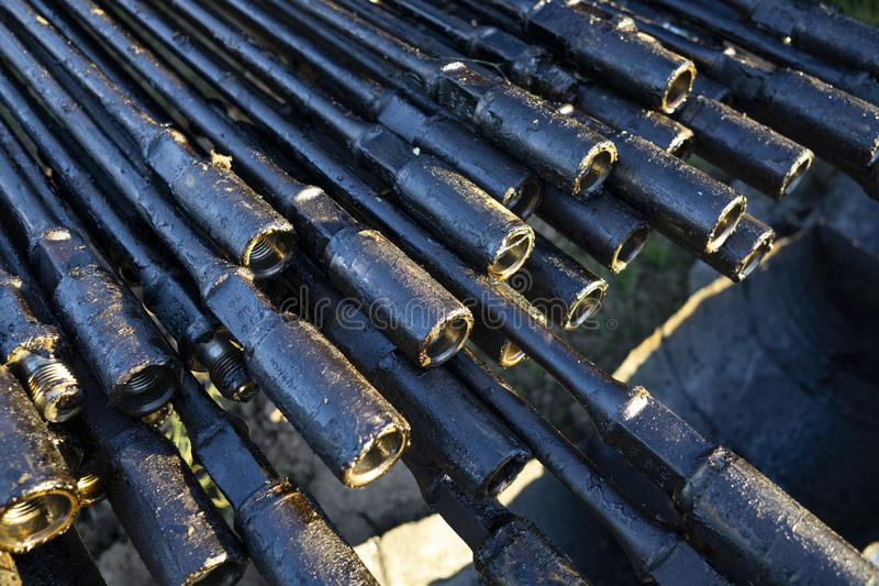 Oil Drill pipe. Rusty drill pipes were drilled in the well section. Downhole drilling rig. Laying the pipe on the deck. View of. The shell of drill pipes laid stock images