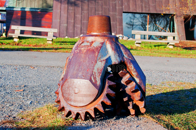 Oil drilling bit. Tricone rock drilling bit for oil well stock photography