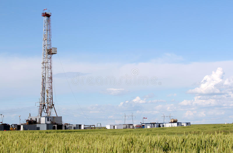 Oil drilling rig. Field with oil drilling rig royalty free stock photo